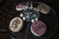 Cork Wine Glass Charms from A-Rae's Shop on Etsy. Would collect corks from significant years (year you met, bought first home, wedding, baby's birth, etc.) and create a lifetime collection of memories to remember over a beautiful glass of wine. Diy Wine Glasses, Painted Wine Glasses, Wine Tasting Party, Wine Parties, Wine Vine, Wine Glass Markers, Wine Cork Crafts, Wine Glass Charms, Recycled Bottles