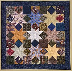 Star Puzzle by Barbara Brackman, 2008. Pattern in Making History: Quilts & Fabric from 1890-1970.