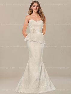 Modern vintage bridal gown is an ideal style for the bride seeking for a slim, contemporary design that will highlight your figure. It has a sweetheart neckline with scalloped trim. The natural waist accents ribbon with flower and asymmetrical draped Lace peplum. Fit and flare skirt finishes with lace hem.