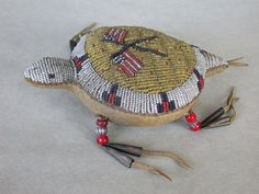 Exceptional old Sioux beaded turtle fetish.  Umbilical cords were traditionally placed inside these fetishes, as a measure of good luck and health for the newborn, and hung from the cradle board. Later, they were often worn by the child or attached to clothing. They were used for protection from evil spirits and kept throughout life.