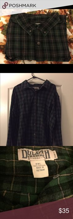"Duluth Trading CO. Free Swingin' Flannel. 2XL. Duluth Trading CO. ""Free Swingin' Flannel."" Trim Fit. Green, black, and gold. Plaid print. Button-down collar. Oversized buttons. Hidden smaller pocket inside breast pocket. Long sleeve. Great condition. 2XL. Duluth Trading CO Shirts Casual Button Down Shirts"