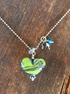❤︎ Womens Heart Pendant Necklace. Green and Blue Heart Necklace. Womens Gift. Lampwork Necklace. Seahawks Necklace. Studio BB Designs ❤︎ Blue and green handmade glass #heartpendant with Swarovski crystal embellishments. This heart is a beautiful color! Perfectly paired with a nickel ball chain. This heart pendant is perfect for the #Seahawks fan in your life! Our handmade glass items are all kiln annealed. This increases strength and durability, these creations will last hundreds of years!