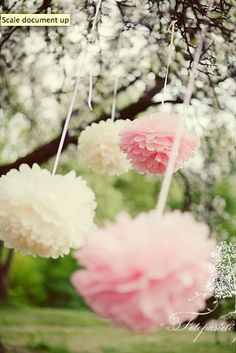 Pom poms in white green blue and pink. For outside?