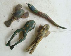 Four Early hand carved ice fishing decoys: 2 frogs, lobster, snake; orig paint *