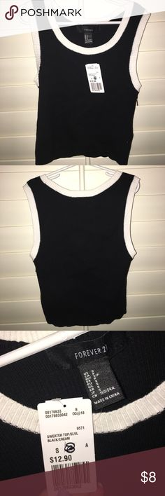 BRAND NEW w/ Tags Forever 21 Black&White Crop Top BRAND NEW w/ Tags Forever 21 Black&White Crop Top! This soft and comfy fitted top is black w/ white trim and would pair perfectly with jeans or high waisted shorts. Super low price for great quality and a trendy look❣️ Forever 21 Tops Crop Tops