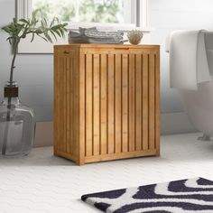 Winston Porter Edward Bamboo Cabinet Laundry Hamper & Reviews | Wayfair Laundry Sorter Hamper, Canvas Laundry Hamper, Wicker Laundry Hamper, Hampers, Laundry Baskets, Laundry Rooms, Bamboo Cabinets, Laundry Center, Square Baskets