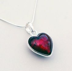 """Murano glass heart Christmas red pendant by Claudette Worters. The perfect gift to give to the one you love this Christmas - or simply treat yourself!This handmade Murano glass heart sterling silver pendant necklace is available in a gorgeous deep, rich Christmas red, the colour of sparkling rubies, roses and red wine! <strong>Why not complete the set? Matching Heart Earrings In Silver And Murano Glass are also available. Other colours also available. Click on """"see seller's complete…"""