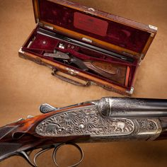 Rodda Maharaja Grade Side-By-Side Double Rifle - In the classic .450/.400 chambering, this Rodda double rifle bears deeply chiseled engraving of tiger hunting in a jungle and elk hunting in a woodland venue. This rifle exemplifies the arms ordered by Maharajahs for Indian big game excursions. Usually on exhibit at the NRA National Firearms Museum in Fairfax, VA