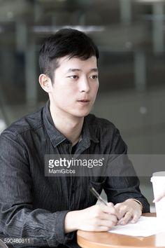 ストックフォト : Young man talking and writing in the office
