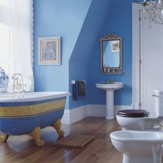TLC Home Bathroom Design Idea: Low-Key Luxury.  This reminds me a little of your bath--the color, the vintage tub, and the white flowing curtains behind the tub.  You wouldn't have to paint the tub--yours is fine in white, but you can see how you could use art work etc. to give a bold color like that a more vintage feel.