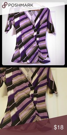 Ann Taylor Factory Purple Striped Wrap Style Top Ann Taylor Factory Purple Striped Wrap Style Top features gathered material in the front .Laying flat it measures 17 inches across the front. The length of the top is 25 inches.The material is 95 % Cotton 5% Spandex Ann Taylor Factory Tops