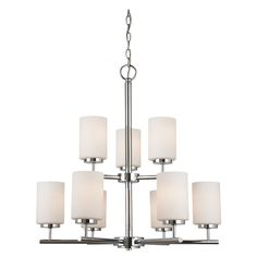 Add a touch of modern elegance to your home when you install this nine-light chrome chandelier. Set with opal white glass shades, this light fixture will beautifully illuminate any room.The steel construction of this fixture ensures durability.
