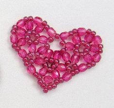 Sandra P. Halpenny's free heart instructions for Valentines Day. Uses Miyuke 8's & 4mm fire polished crystal ~ Seed Bead Tutorials