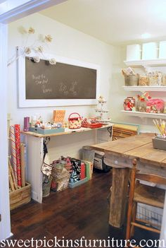 "Amazing Craft Room with cool old door chalk board & a ""glue gun station"" made from another old door."