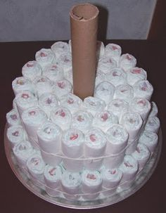 Diaper Cake Instructions | cool before adding diapers tie these diapers snuggly around your tube ...