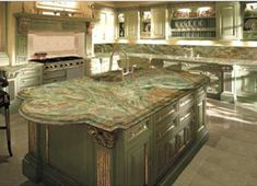 Seeing as I'm trying to keep the main fixtures in my bathroom, designing is a little difficult. I came across this Forest Green Marble countertop and actually think it looks nice Green Granite Kitchen, Green Granite Countertops, Kitchen Countertops, Hacienda Homes, Hacienda Style, Back Bar Design, Green Cabinets, Kitchen And Bath Design, Small Spaces