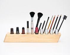 Wooden makeup brush organizer.#DailyCandy