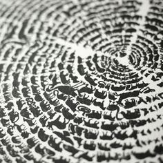 "This is an amazing print.  Tree of Life  by Gary, Aaron & Khairul  -description from http://plentyofcolour.com/category/in-black-white/  ""From afar, the piece looks like a textured tree ring but upon viewing up close, the rings turn out to be hundreds of graphic animals walking in procession around the tree ring curves. ... Tree of Life is a pretty perfect print – meaningful, clever and striking with an socially conscious soul."""