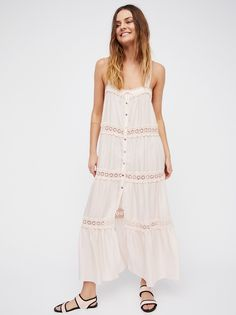 Simply Peasant Slip   Peasant-style maxi slip featuring sheer crochet panels with sweet ruffle accents. Tiered hem and relaxed fit make for a sweeping, effortless silhouette.