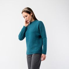 Promenade is an easy to wear pullover featuring dramatic dropped shoulders, a rolled hem, and flattering shaping. Unexpected cable texture at the sides and collar lends an extra touch of sophistication. How To Purl Knit, Knit Purl, Sweaters For Women, Women's Sweaters, Rolled Hem, Knitting Patterns, Pullover, Cable, How To Wear