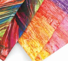 Learn how to create the look of finger painting by printing on fabric using monoprinting techniques with a plate.