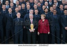 NOVEMBER 10, 2014 - BERLIN: Joachim Gauck, Angela Merkel - official reception of the German national football team (world champion 2014) at the Schloss Bellevue by the German Federal President. - stock photo