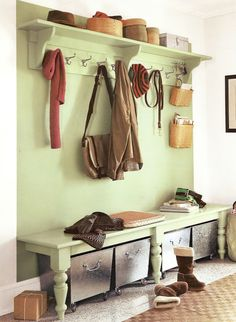 High wall-mounted shelf at back entry, with hooks below and bins/baskets above