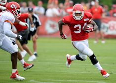 Kansas City Chiefs running back Knile Davis carries the ball during an NFL football training camp Saturday, July 26, 2014, in St. Joseph, Mo