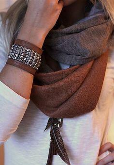 Leather cuff, infinity scarf, and feathered pendant.
