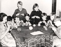 Children assist the war effort by knitting, 1942. (Canadian War Museum)