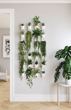 Indoor: Functional and fresh, the Floralink Wall Vessel from Umbra has multiple purposes and can be used as a planter or to hold your belongings. Connect vessels together to create a visually impactful and open green wall display. House Plants Decor, Plant Decor, Bedroom With Plants, Bedroom Green, Living Room Plants Decor, White Bedroom, Bedroom Decor, Bedroom Rustic, Garden Bedroom
