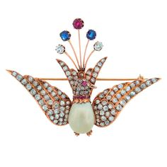1900s Natural Pearl Diamond Ruby Sapphire & Rose Gold Peacock Brooch Pin | From a unique collection of vintage brooches at https://www.1stdibs.com/jewelry/brooches/brooches/ photo 1/6