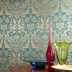 Add a sophisticated touch to your living room or den with this eye-catching wallpaper, showcasing a damask motif in teal and gold.