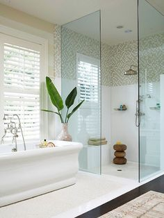 Highlight the different zones in your bathroom by laying your tile within a boarder and changing materials.