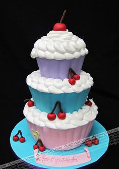 Now I want cupcakes. (This is a 1st Birthday Cake? Wow. Tough act to follow for birthday No. 2) By Design Cakes.