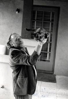 Charles Bukowski with his cat.