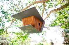 I could make this instead of paying for this Modern Birdhouse-Walnut finish. $150.00, via Etsy.