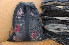 We are happy to see you in our shop!  Denim storage bag The bag is made of recycled denim fabric with decorative with embroidery The bag with drawstring closure Dimensions approx - 14 1/2x15 1/2 inch (37x31 cm)  Not exactly what youre looking for? More of storage are available here:https://www.etsy.com/ru/shop/SecondBirthday?ref=hdr_shop_menu&section_id=17168248  I am happy to realize your dream :)  All of our products are a 100% hand made, cr...