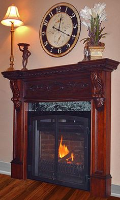 Lincoln wood mantel, $1198. Made to fit many of the small gas or electric fireplaces offered at Victorian Fireplace Shop