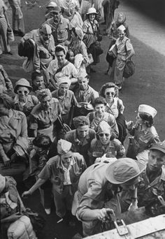 US Army nurses boarding cargo plane for transport after they were liberated from Japanese internment camps during WWII. Location:Manila, Luzon, Philippine Islands Date taken:February 1945 Photographer:Carl Mydans