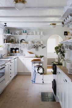 love white kitchens! one day. in my dreams. where we are clean enough to have an all white kitchen.