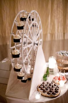 My husband, then fiancé, made a cupcake ferris wheel for our wedding! - Imgur