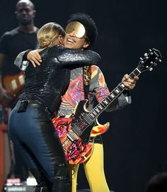 Prince performs with singer Mary J. Blige onstage during the 2012 iHeartRadio Music Festival at the MGM Grand Garden Arena on September 22, 2012 in Las Vegas, Nevada.