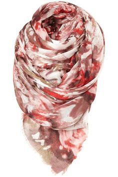 Multi coloured lightly woven scarf with all over faded floral print.
