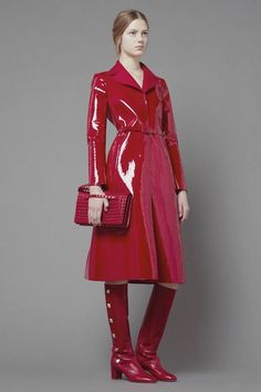 Red slick red vinyl rain coat with coordinating boots and purse.  Love the spikes on the handbag!
