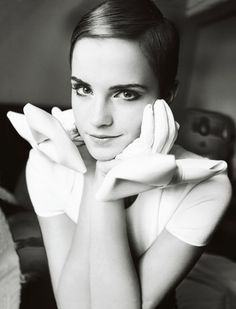 Emma Watson photographed by Mario Testino for the December 2010 issue.
