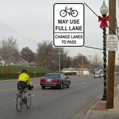 Street signs in Ferguson reflect greater lane leeway for cyclists. Would love to see this everywhere.