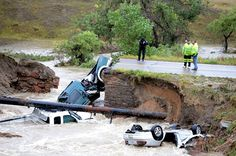 A bridge collapse on a business access road at Highway 287 and Dillon Road in Lafayette causes 3 cars to fall in the creek. Cliff Grassmick ...