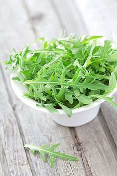 Arugula... a little olive oil, lemon juice, sea salt and p.  So good, and good for you.