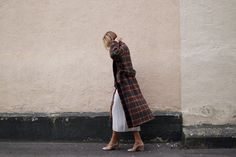 Checked coat from House of Dagmar, knitted dress from COS, shoes from Mango and bag from Stella McCartney.